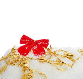 Christmas red ribbon on snow — Stock Photo