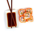 Sushi with chopsticks isolated over white background — Zdjęcie stockowe