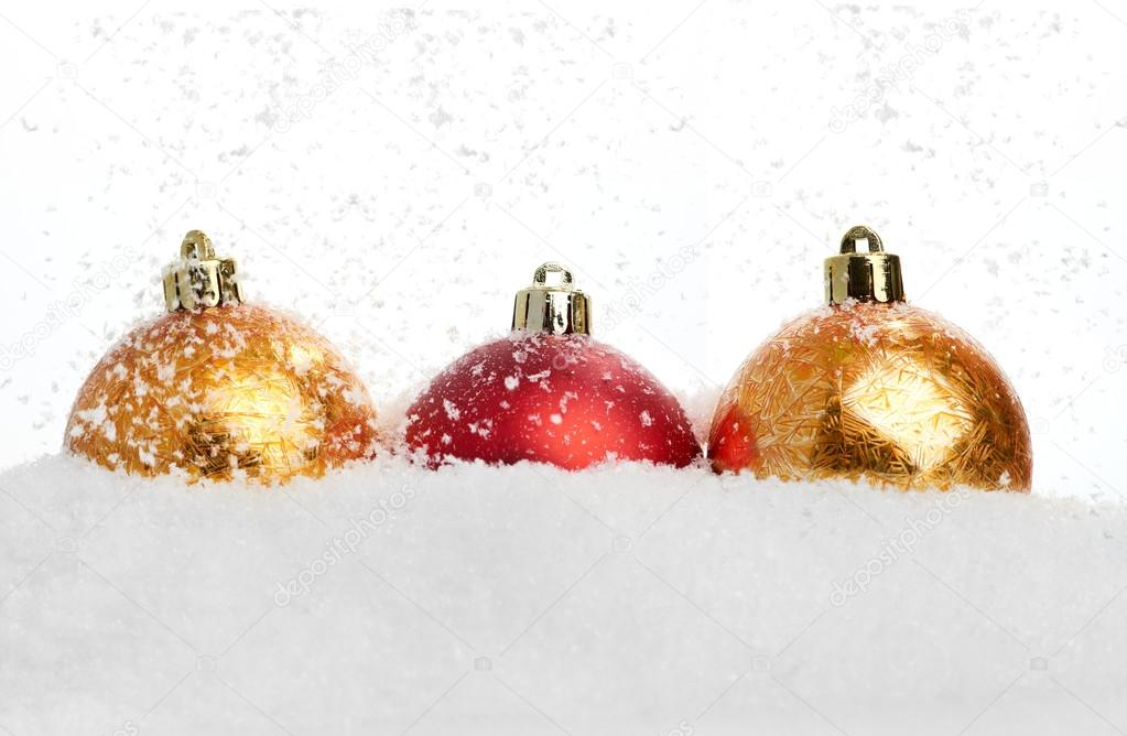 Three christmas balls in the snow on white — Stock Photo #16963975