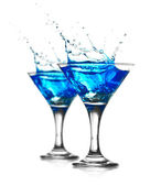 Blue curacao cocktail with splash — Stock Photo