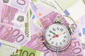 Alarm clock for euro banknotes — Stock Photo