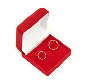 Wedding rings on red box isolated on white background — Foto Stock