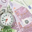 图库照片: Alarm clock for euro banknotes