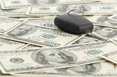 Car Key on 100 dollar background — Stock Photo