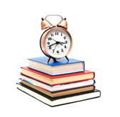 Clock and books on a white background — Stok fotoğraf