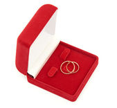 Wedding rings on red box isolated on white background — Stock Photo