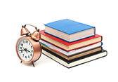 Clock and books on a white background — Stockfoto