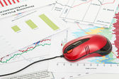 Financial graph with computer mouse — Stock Photo