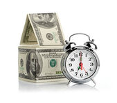 House made of dollars and alarm clock. — Foto Stock