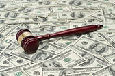 Gavel on dollar background — Stock Photo