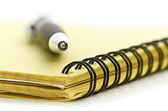 Notepad and pen — Stockfoto