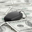Car Key on 100 dollar background — Stockfoto