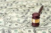 Gavel on dollar background — Stock Photo