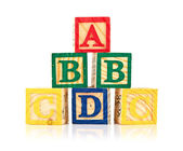Wooden cube alphabet — Stock Photo