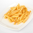 Potatoes fries in the plate isolated on white — Stock Photo #27472981