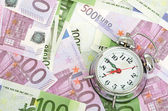 Alarm clock for euro banknotes — Photo