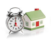 Toy House and alarm clock — Stockfoto