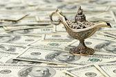 Aladdin lamp on dollar background — Stock Photo