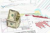 Dům dolarů. na pozadí grafu — Stock fotografie