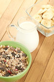 Delicious and healthy cereal in bowl with milk — Stock Photo