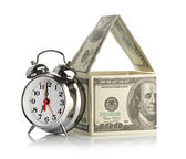 House made of dollars and alarm clock. — Stock Photo