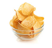 Delicious potato chips in bowl isolated on white — Stock Photo
