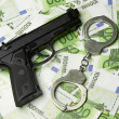 Stock Photo: Image of old gun and money