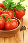 Tomatoes in wooden bowlin — Stock Photo