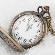 Vintage clock on snow background — Foto de Stock
