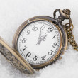 Vintage clock on snow background — Stockfoto