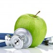 Medical stethoscope and apple — Stock Photo #32557385