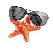 Sea star and sungasses — Stock Photo