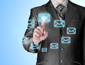 Arm press button in envelope icon on touch screen — Stock Photo
