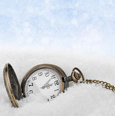Vintage clock on snow background — Photo