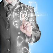 Affärsman röra ljus idé — Stockfoto