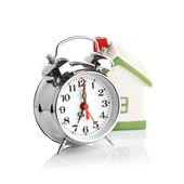 Casa de juguete y reloj despertador — Foto de Stock