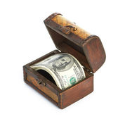 Dollar-bills in the old wooden treasure chest — Stock Photo