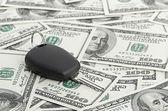 Car Key on 100 dollar background — Stock Photo