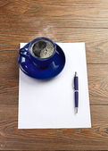 Blue coffee cup on white blank — Stock Photo