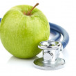 Stock Photo: Medical stethoscope and apple