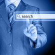 Businessman pushing virtual search bar — Stock Photo