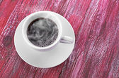 Coffee cup with space on the wooden table — ストック写真