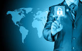 Businessman touch lock on world map background — Stock Photo