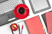 Laptop and office supplies — Stock Photo