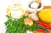 Fresh cooking ingredients with olive oil — Stock Photo