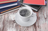 Cup of coffee and business notebooks — Stock Photo