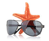Sea star and sunglasses — Stock Photo