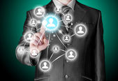 Businessman pressing modern social buttons — Stock Photo