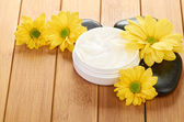Cream with flower — Stock Photo