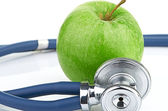Stethoscope and apple — Stock Photo